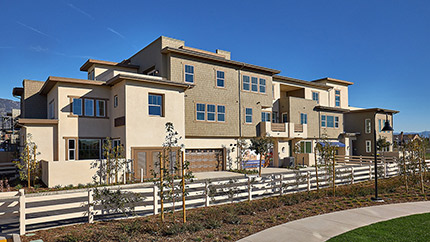Focused shot of the entrance gates exhall townhomes